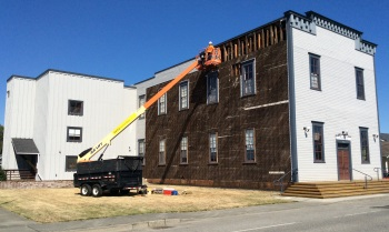Photograph of siding repair on Floyd Norgaard Cultural Center
