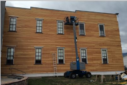 New siding being added to south wall of the Floyd Norgaard Cultural Center