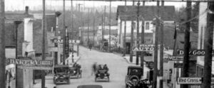 Cropped from a street view of Main Street in 1917 showing the two story Thompson Hall moved across the street by the Sons of Norway and converted to their hall.