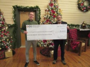 Snohomish County Clouncilman Nate Nehring and Richard Hayes presenting Community Heritage Grant check for historic preservation repairs and maintenance of D. O. Pearson House.